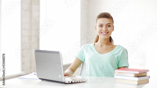 happy student working with laptop