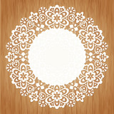 Ornamental round lace pattern on grunge background