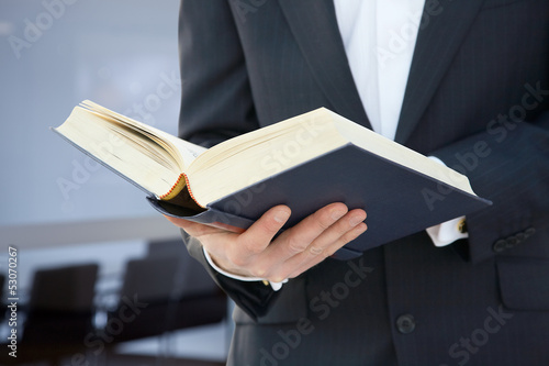 business man working with a book