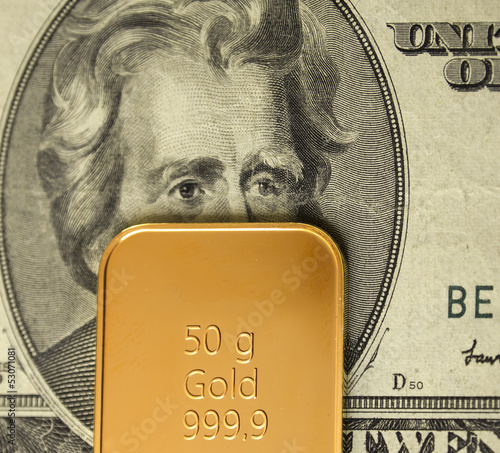 50g gold bar / ingot on a 20 Dollar note