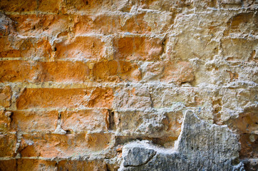 Background texture of an old wall of clay bricks