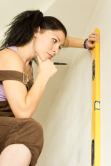Young attractive woman using spirit level