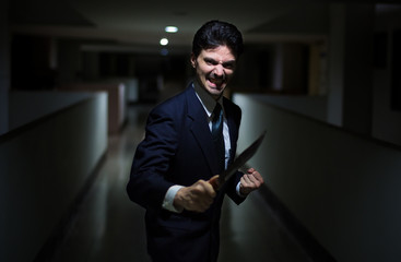 The killer in a suit with a knife