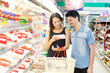 couple buys meat at the supermarket