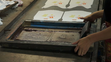 Manual silk screening.
