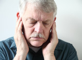 senior with pain in front of ears