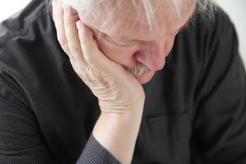 unhappy older man