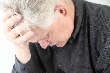 very depressed older man