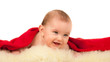 Portrait of sitting little baby boy on a white background