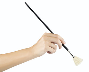 woman paints a picture with a brush