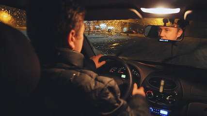 driver in car. night driving on the winter road
