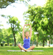 Young woman exercising in a park on a sunny day