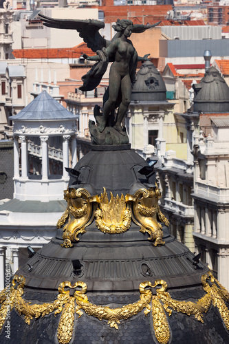 Aerial view of Madrid  / Famous sculpture and roofs of the city