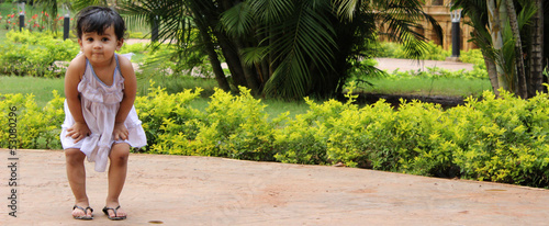 Playful Girl Child in Garden