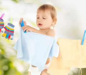 baby doing laundry