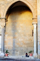 Under a norman arch of the famous Cefalu cathedral, Sicily