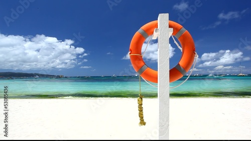 Lifebuoy ring on tropical beach