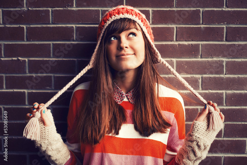 Portrait of young pretty funny smiling girl in cold weather