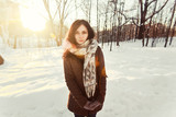 Young attractive girl posing in winter park