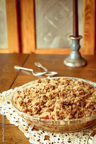 Crumb topped apple crisp dessert cooling by window