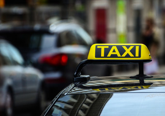 Taxi sign on car