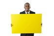 Businessman Holding Big Yellow Board