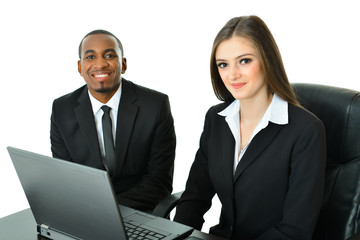 Two Co-Workers Sitting and Working