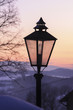 Winter landscape at twilight. Black vintage lantern