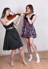 Music practice for two girls in a same sex relaionship