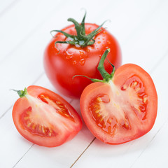 Vegetables: ripe tomatoes on wooden boards
