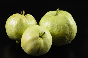 Guava on black background