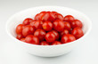 Fresh, ripe cherry tomatoes in a white bowl