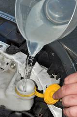 Car Windscreen Washer Bottle Being Filled