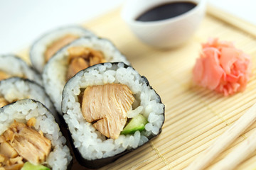 Teriyaki chicken sushi rolls with cucumber, ginger and soy sauce