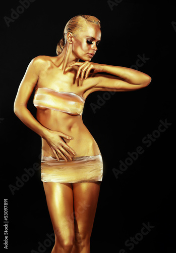 Golden Woman over Black Background. Creative Contemporary Design