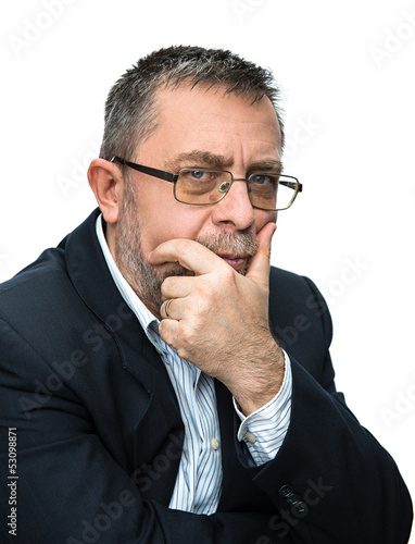 Senior businessman thinking with his hand at the chin.