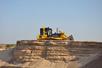 Bulldozer move sand at a sand mine