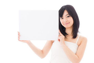 attractive asian woman holding blank whiteboard
