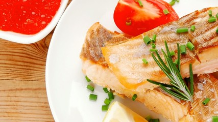 savory sea fish : baked salmon strips dish with red caviar over