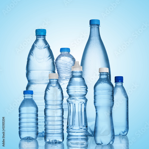 many water bottles on blue background