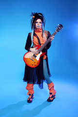 Rock girl posing with electric guitar playing hard-rock isolated