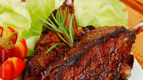 served ribs with cutlery on wooden table 1920x1080 intro motion