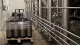 Filling (packaging) fresh beer in a beer kegs at a brewery.