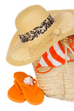 straw hat and  basket for beach