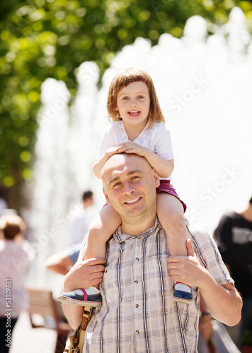 father with baby  in summer street