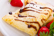 Crepes with chocolate syrup and strawberry