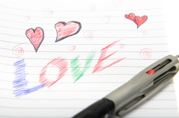 Love Written in Notebook With a Pen.