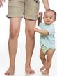 standing holding mom leg