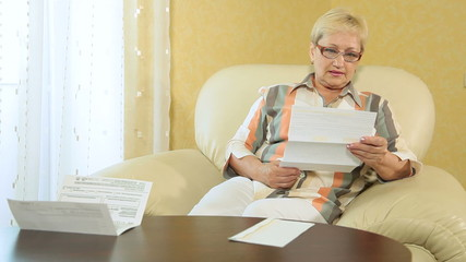 Woman looking over financial papers