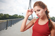 Beautiful woman after fitness training on bridge